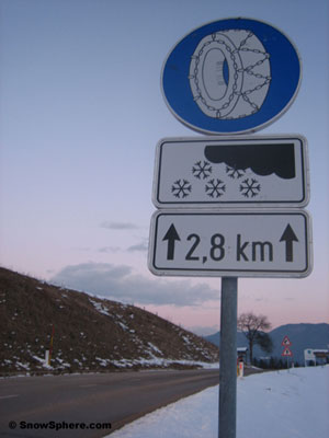 snow chain road sign