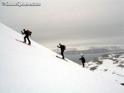 hiking a mountain on skis in iceland